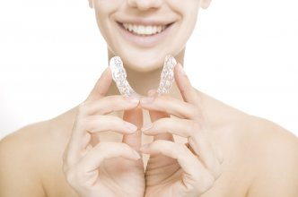 http://www.dreamstime.com/stock-photography-smiling-girl-tooth-tray-beautiful-hands-holding-individual-image35235142